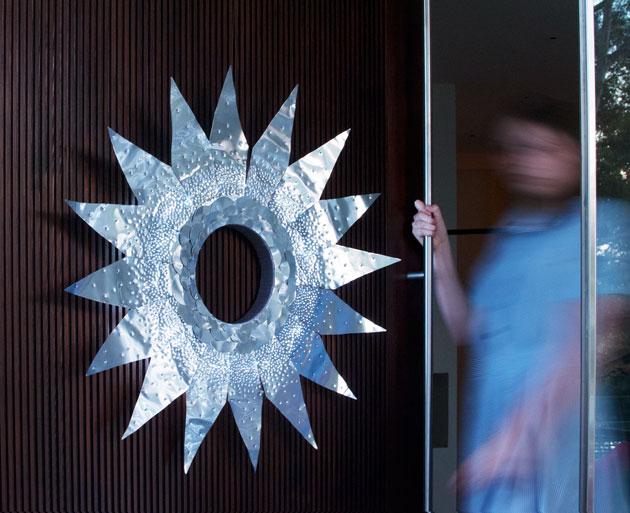 Walking-through-door-with-wreath