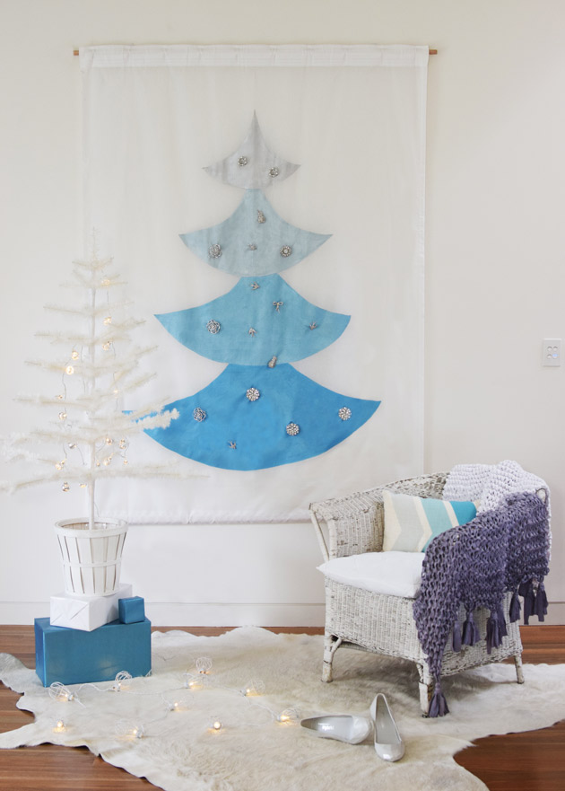 Pinning-brooches-onto-Christmas-Tree-Painted-Mural